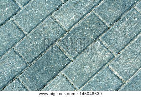 Close-up Of Grey Pavement Cobble Stones.