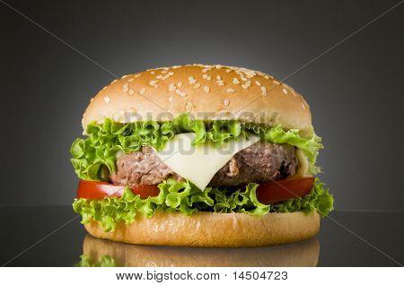 Big fresh delicious homemade hamburger with reflection