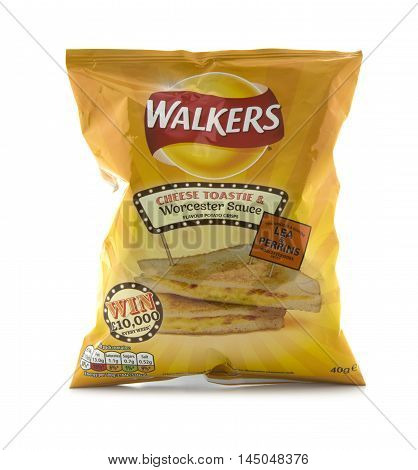 SWINDON UK - AUGUST 27 2016: A Bag of Walkers Cheese Toastie and Worcester Sauce Flavour crisps isolated on a white background. Walkers is a British snack food manufacturer