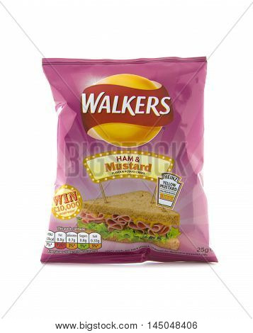 SWINDON UK - AUGUST 27 2016: A Bag of Walkers Ham and Mustard Flavour crisps isolated on a white background. Walkers is a British snack food manufacturer