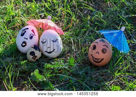 Funny eggs imitating white parents with versicolored baby and coloured male friend