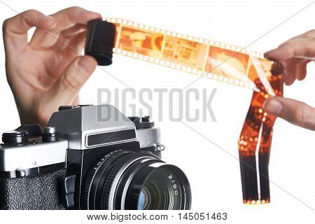 Hands With Color Negative Near Slr Camera Isolated