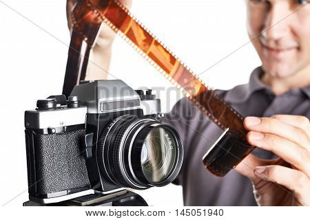Photographer With Color Negative Near Slr Camera Isolated