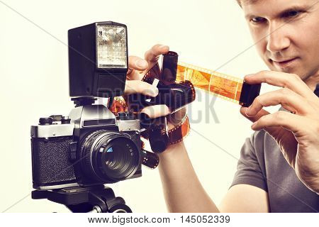Photographer With Color Negative Films Near Slr Camera Isolated