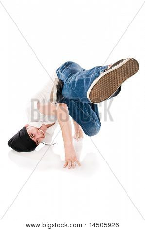 Young happy breakdancer standing on hands with a flying kick