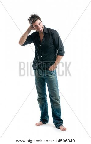 Smiling young latin man looking at camera with embarrassment isolated on white background
