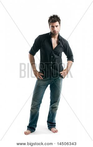 Stylish young latin man posing full length and looking at camera isolated on white background