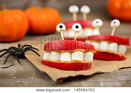 Healthy Halloween Apple, Marshmallow, Peanut Butter Monster Teeth On A Rustic Wooden Background
