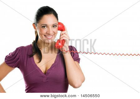 Young casual woman holding a red receiver and smiling at the phone call