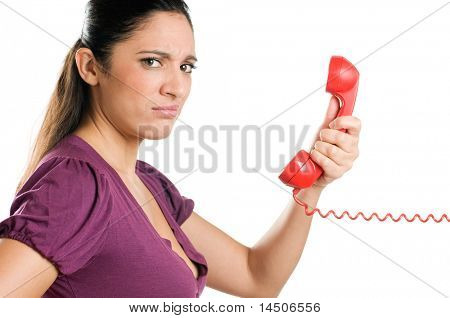 Surprised young woman looking at camera with astonishment during a phone call isolated on white background