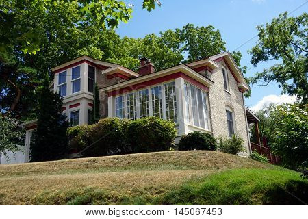 An elegant brick home with a solarium on a hill near downtown Petoskey, Michigan