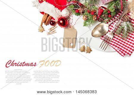 Christmas food concept - plate with fork and spoon with christmas decoration top view isolated with sample text