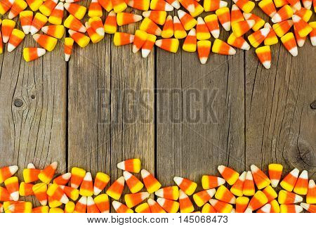 Halloween Candy Corn Double Border Against A Rustic Wood Background