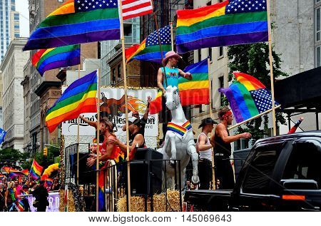 New York City - June 29 2013: Colourful float and riders flying the rainbow flag at the 2013 Gay Pride Parade on Fifth Avenue