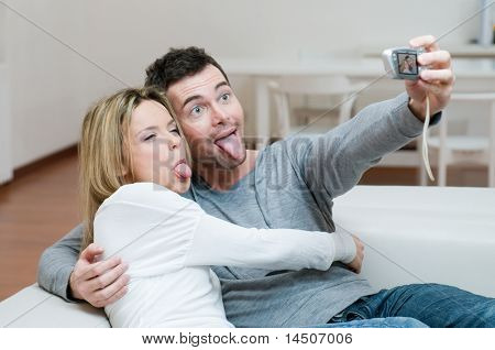 Young couple making a funny face while taking a self portrait