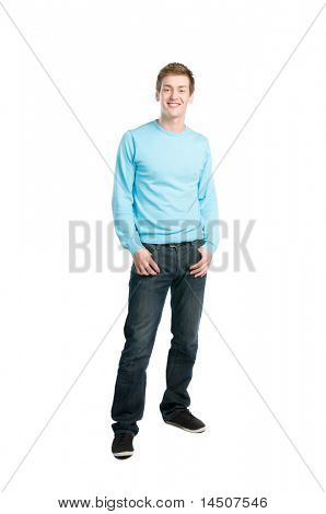 Happy young relaxed man smiling and standing isolated on white background