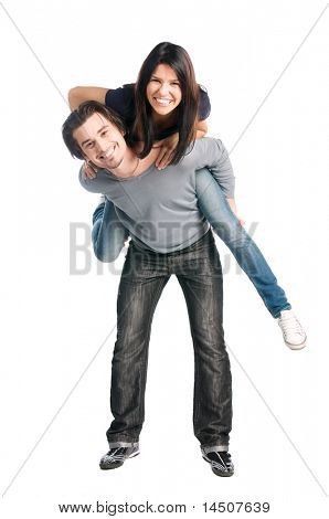 Young happy latin couple playing together piggyback isolated on white background