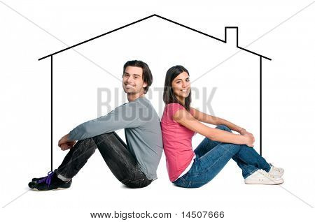Happy young latin couple dreaming about their new home isolated on white background