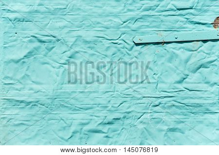 Greenish background: metal surface with mint paint and creased texture