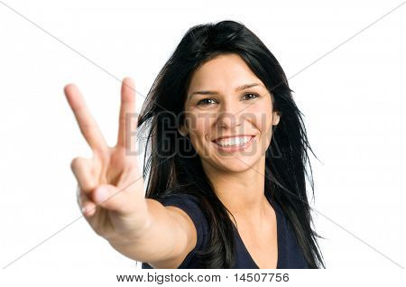Young latin teenager girl showing victory sign isolated on white background