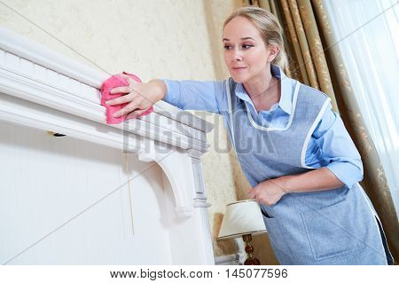 Cleaning service. hotel staff removing dust
