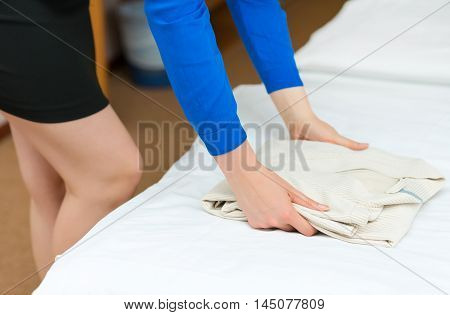 Room Service. Woman Changing Bathrobe In Hotel Room.