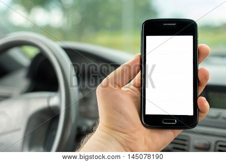Man Using Mobile Phone In Car. Blank Screen For Your Text.