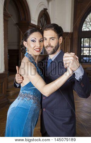 Smiling Tango Dancers Performing In Restaurant