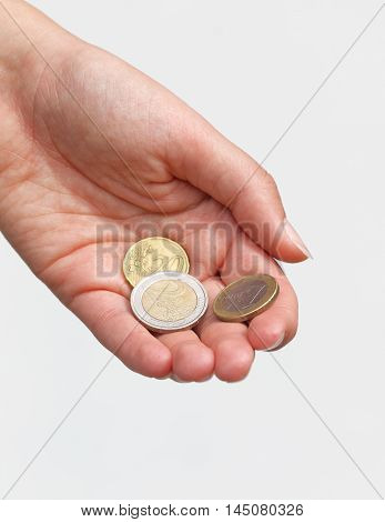 Paying - Hand giving some Euro coins
