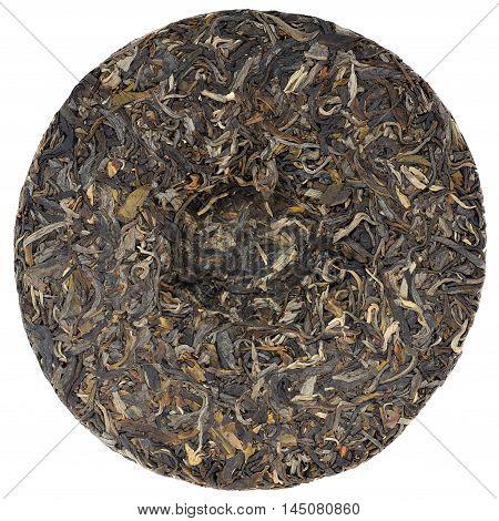 Myanmar raw puerh tea with stone impress overhead view isolated