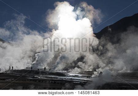 Geysers del Tatio / Tourists near erupting geysers, Geysers del Tatio, Chilean Andes, Atacama, Chile