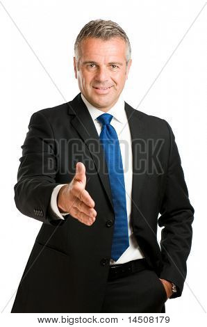 Friendly mature man giving hand for an handshake to seal the agreement isolated on white background
