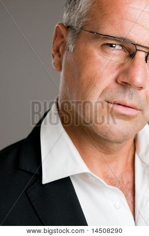 Closeup portrait of pensive mature man with glasses