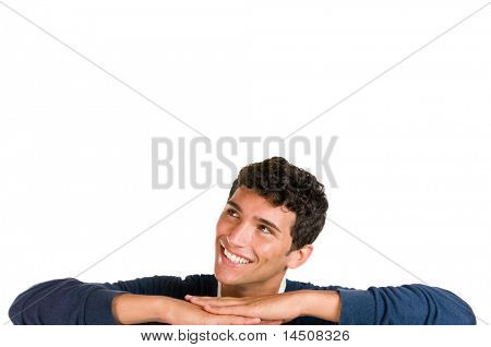 Smiling young man looking up at copy space for your text isolated on white background