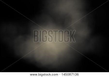 Circular bokeh dark background with creamy white patches of light