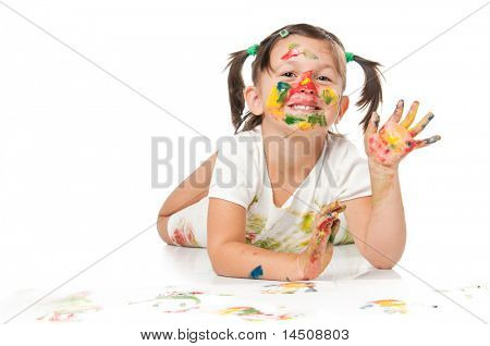 Happy smiling little girl playing with colors and waving hello isolated on white background