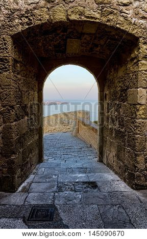 Sea in a chink of Santa Barbara castle in Alicante, summer Spain