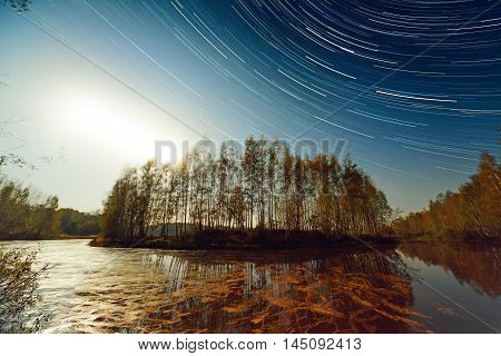 Sunset And Star Trails Over Lake