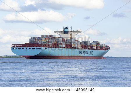 Stade, Germany - August 21, 2016: EDITH MAERSK, one of the world??s largest cargo ships, operated by Danish shipping company Maersk Line, near Hamburg on Elbe river.