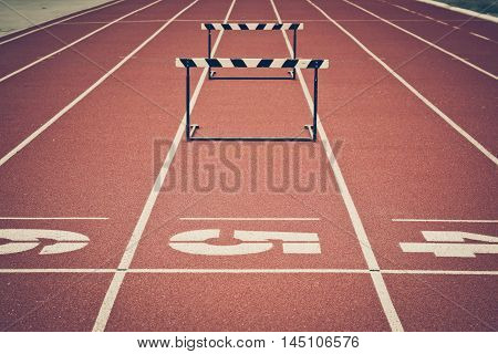 Jump hurdle on running track in a stadium