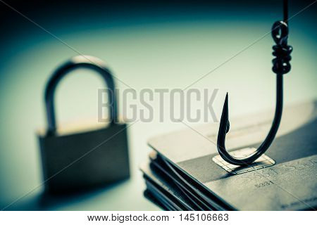 Cyber crime. Credit card phishing attack. A hook and lock on credit cards poster