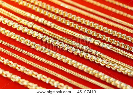 Gold necklace on a red cloth background