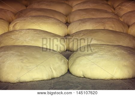 Baking Raw Dough in the Traditional Bread Oven