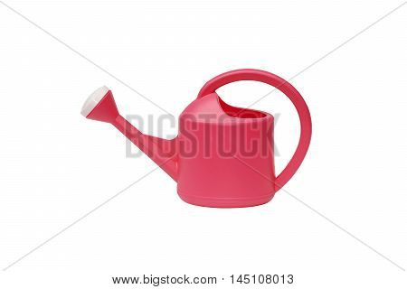 Plastic watering can in red color isolated