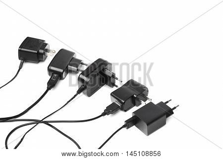 Different types of adapter charger on isolated background