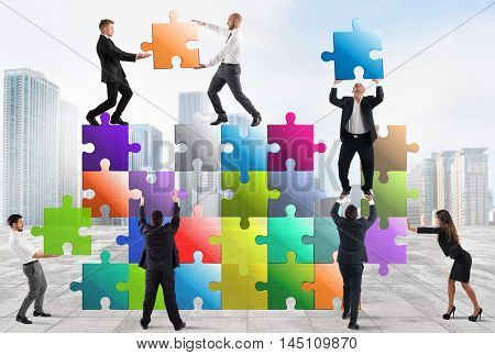 Team of businesspeople build a puzzle construction