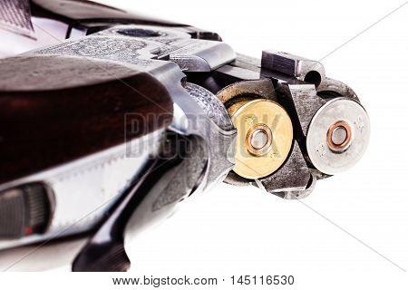 Loaded Shotgun On White