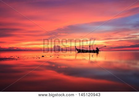 Silhouette Traditional Longtail Boat And Beautiful Red Sky And Sunset At Samui Island, Thailand