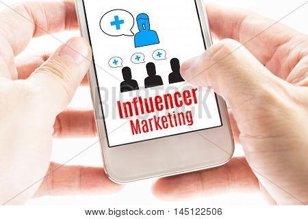 Close Up Two Hand Holding Smart Phone With Influencer Marketing Word And Icons, Digital Concept