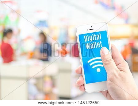 Hand Holding Mobile Phone With Digital Wallet At Supermarket Blur Background, Digital Economy Concep
